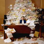 desk-with-pile-of-papers